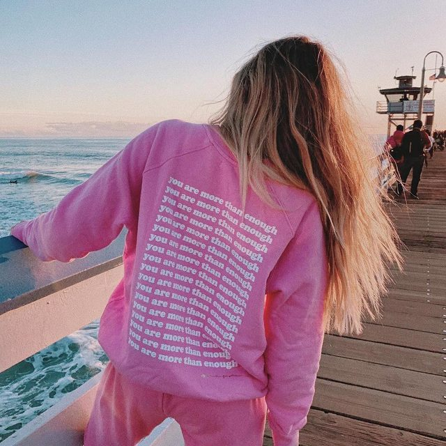 Spread the word 💖💖 @whitneybearr in the You Are More Than Enough Sweatshirt + Heart Perfect Sweatpant — tap to shop #selfcaresunday #raiseyourvibration #spiritualgangster