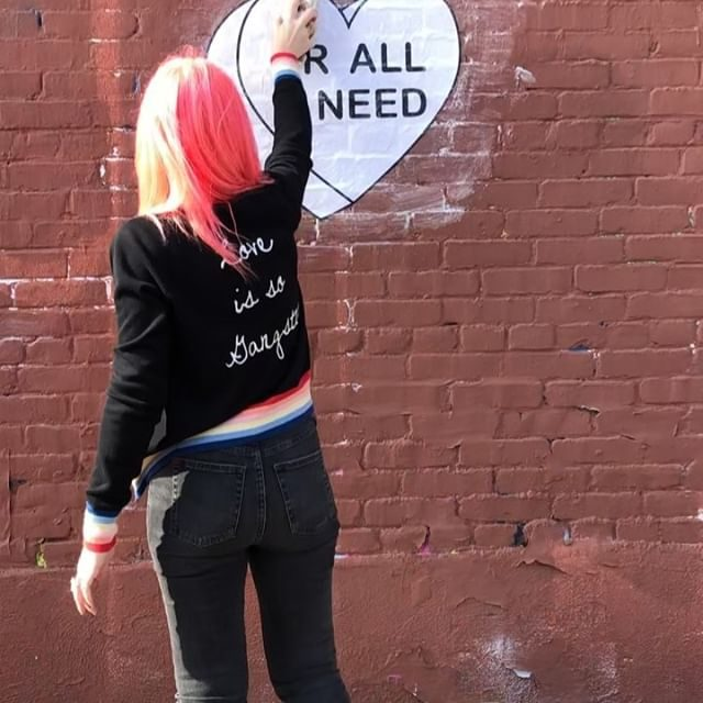 Today and every day 🖤🌈🖤 @amberellaxo spreading the word in the Stripe Knit Bomber — link in bio to shop our favorite love styles #spreadlove #uralluneed #SGxAmberella