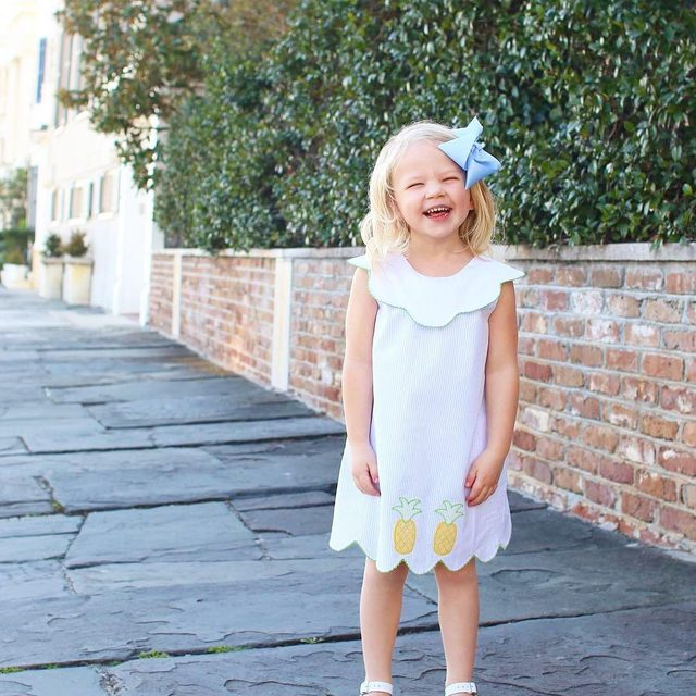 All smiles here in Charleston because this recent weather means summer is on its way! Beach and boat days ahead = 😊 And this darling seersucker dress is available in sizes 2T-8 through the link in our profile 🍍🍍   @lewissu50