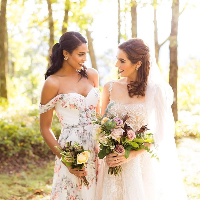 Your ceremony wouldn't be complete without your maid of honor. She'll shine in this elegant floral dress ✨ click to shop!