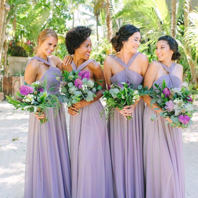 These pretty #bridesmaid dresses have a unique twist! Click to shop ✨ | Photo: @jacquicole | Planning & Production: @tropical_os | Floral Design: @vanessajaimesfloraldesign | Bridesmaid Fashion: #kleinfeldbridalparty | H&MU @stylingtrio | Video: @lerevefilms | Venue: @CasaMalca | #KleinfeldXTulum