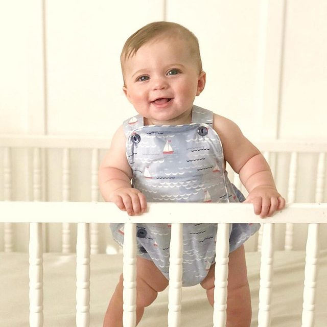 The more rolls, the better..right? 😍😍 Our Morris Island Romper is available in 3m-3t, $32. Shop the link in our profile.   @jillwarley your little boy is edible.