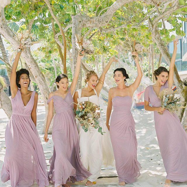 Mood when all your bridesmaids dresses were under $200! Click to shop 💐 | Photo: @JacquiCole | Planning: @tropical_os | Floral Design: @vanessajaimesfloraldesign | Bridal Fashion: @kleinfeldbridal | Bridesmaid Dresses: @kleinfeldbridalparty | Venue: @casamalca | Video: @LeReveFilms | H&MU @stylingtrio #kleinfeldxtulum