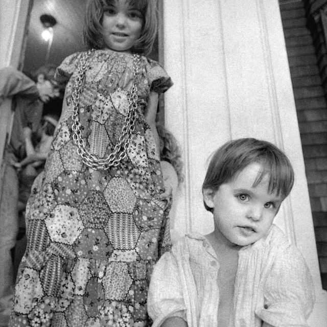 """When asked where she is from, Guinevere Turner usually says """"Upstate New York."""" The truth is, she grew up in an apocalyptic cult with compounds across the country—in Kansas, L.A., San Francisco, New York, and Boston. This photo was taken at the family's Boston compound in 1971. At the link in our bio, Turner tells her story, and explains why, when she was kicked out of the cult at age eleven, she begged to be allowed to stay. Photograph by Michael Dobo / Dobophoto."""