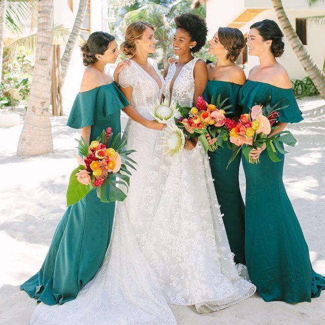 So much love 🌿❣️ | Photo: @jacquicole | Planning & Production: @tropical_os | Bridesmaid Dresses: @KleinfeldBridalParty | Bridal Fashion left: Alyne by Rivini | Bridal Fashion (right): @TonyWardCouture | Bridal Accessories: #Kleinfeld | Floral Design: @vanessajaimesfloraldesign | Groomswear: @theblacktux | Venue: @ZorbaTulum | H&MU: @StylingTrio