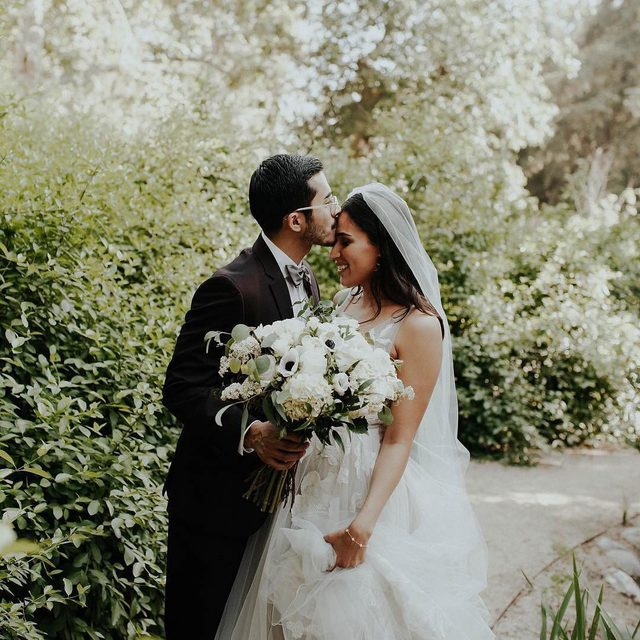Sweet forehead kisses from the one you love 💕 (tap to shop the Hearst Gown | #BHLDNbride @elizabethlramos 📷: @ardorphoto @vrarreola 💐: @ks_floral_concepts)