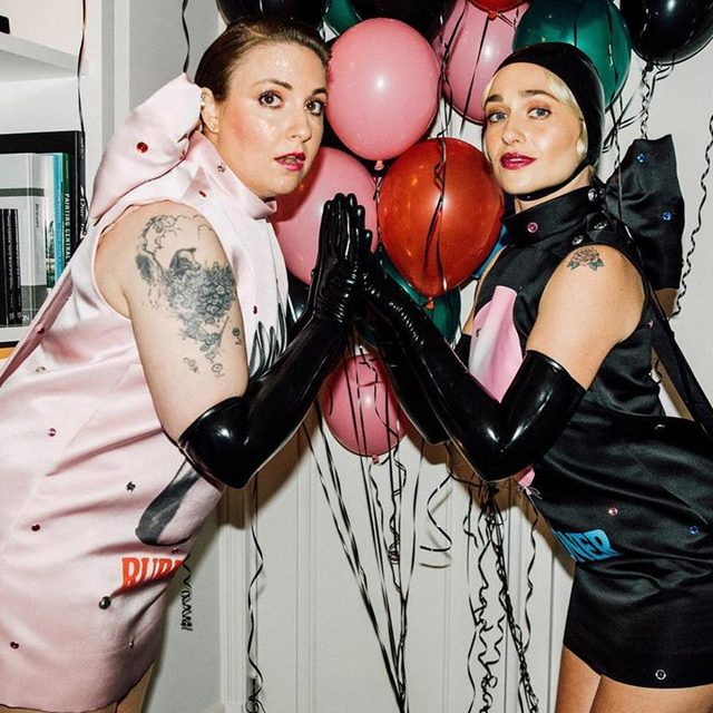 """I think this one is a way to make sure that everyone fucking does the theme, because you can't really do this one half-assed."" #LiquidLadies @lenadunham and @jemima_jo_kirke crack jokes, tell stories of #metgala past, and get ready in their utterly unmissable matching @ChristopherKane outfits in the form of fetishized screen-printed, duchess satin dresses as they get ready for the campy carpet. See it all—including rubbing their arms up in lube, to better ease them into their matching latex gloves—at the link in bo. - Photography: @ysaperez  Wmagazine.com"