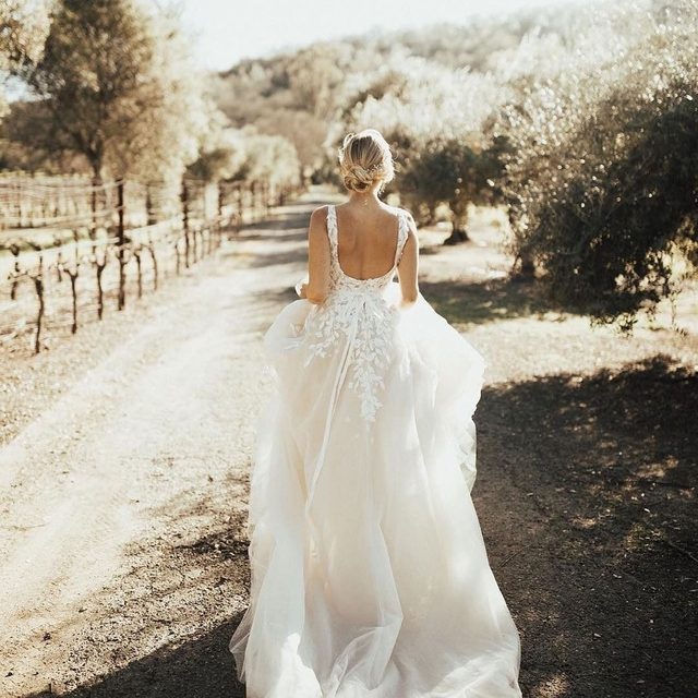Run away with me✨ (tap to shop the Carmel Gown | 📸: @christyljohnston Bride: @ashbegash Venue: @charleskrugweddings at @charleskrugwinery in @VisitNapaValley) #VisitNapaValley #CharlesKrug #CharlesKrugWinery #BHLDNinNapa