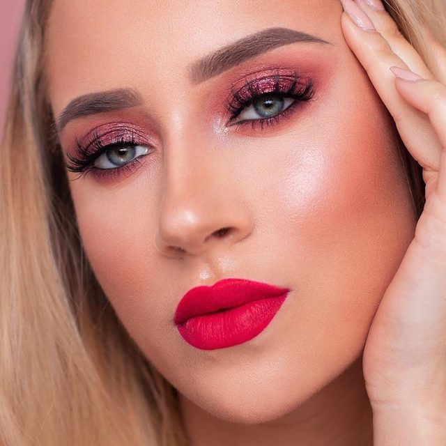 @visamona glams up this pink glitter smokey eye with our OG classics, Doll Me Up and a red lip.  Tap to get the look! #VelourLashes #DollMeUp #lashesonfleek #liveinlashes