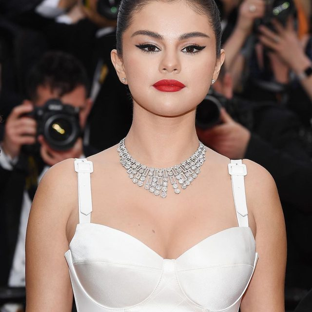 Selena Gomez just made her Cannes film festival debut in a white hot #LouisVuitton gown. Link in bio for all the gorgeous photos. 🔥🔥🔥