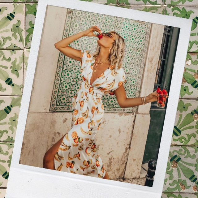 fresh & fruity 🍊🍌🍓 @tezza wearing @songofstyle Sia midi dress - tap image to shop! #revolvearoundtheworld #songofstyle