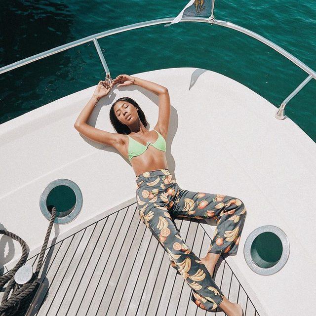 main squeeze 🍊🍋❤️ @tatianaelizabethh in the @loversfriendsla the feels bikini top + @songofstyle blaire pants #revolvearoundtheworld