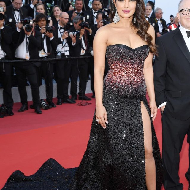 #PriyankaChopra just made her Cannes debut in a sparkling #RobertCavalli gown. Link in bio for all the stunning photos. ✨✨✨