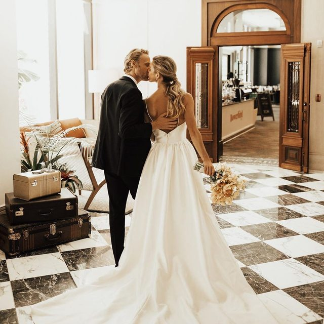 You put your arms around me & I'm home.❣️(tap to shop the Opaline Ballgown | 📷: @christyljohnston 💏: @avajohanna & @corey.mccomb Venue: @perrylanehotel Tux: @theblacktux Flowers: @urbanpoppyshop) #BHLDNinSavannah