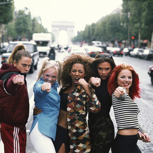 Five women in a band together, all sharing songwriting credit and vocal duties equally, was a new concept in British pop in 1996; the Spice Girls were all about making everyone feel included. Read the review of their debut album in the link in our bio. — 📷 by Tim Roney/Getty Images