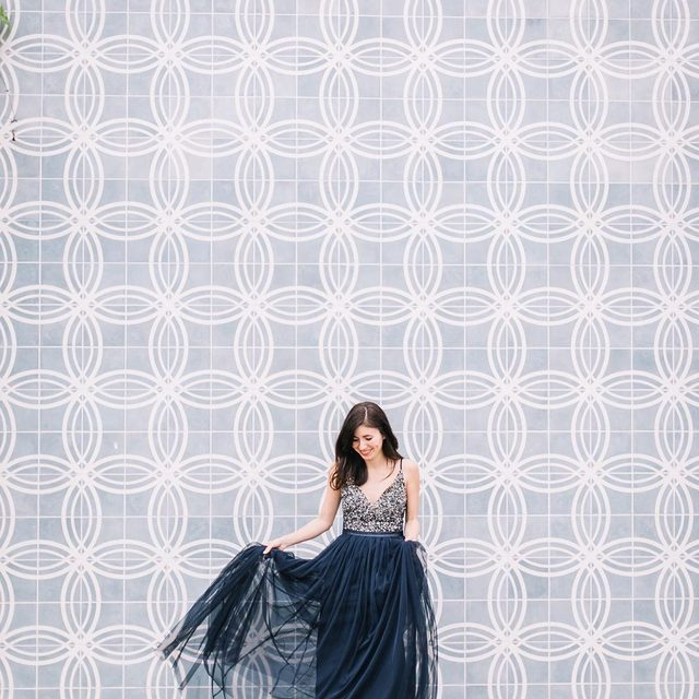 How beautiful is @leopardmartini1 in our Avery Dress in Midnight! 💙Find all new bridesmaid dresses & styles by clicking the link in our profile to shop! 📷: @howdybrandon #BHLDNBridesmaids