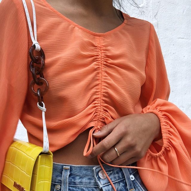 A modern take on the going-out top #SummerofShopbop 🍊✴️🧡💥