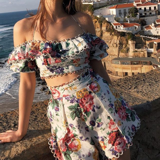 We can't decide what's more stunning... this floral @zimmermann set or the picturesque Portuguese backdrop 📸