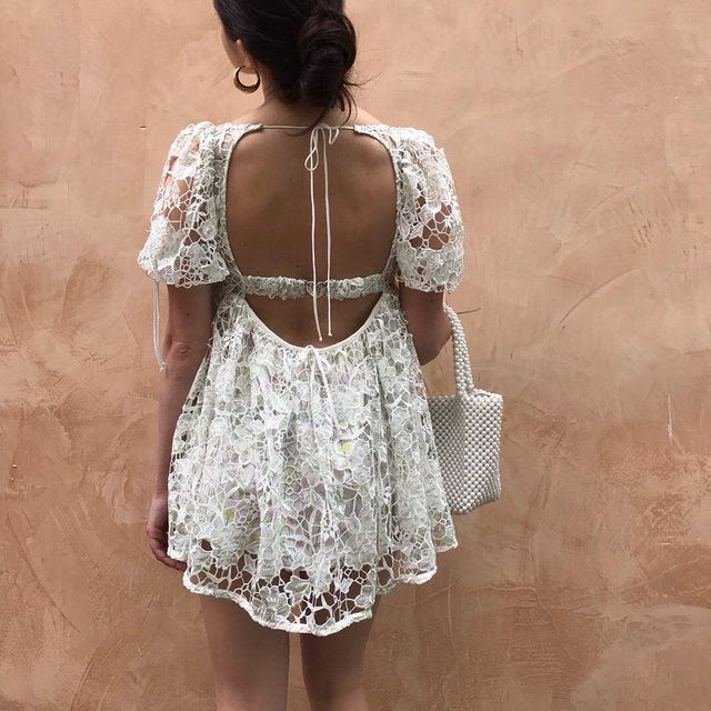 We use a lot of negative space embroidery in our designs because the fabric details underneath are just as important as the top layer | The Sundae Mini Dress #summer19