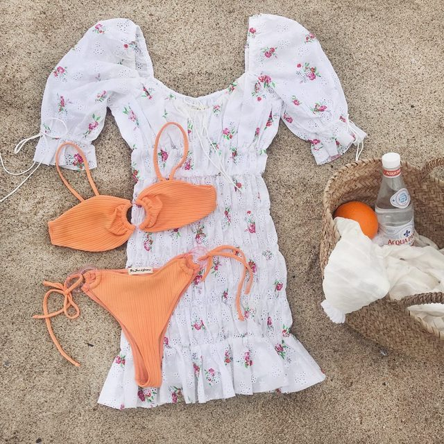 Tell us a summer love story using only emojis 👇| The Tarte Eyelet Smocked Dress and Daiquiri Ring Bandeau Top and Bikini Bottom #summer19