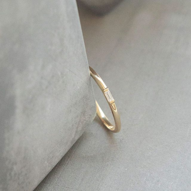 """""""It was a gift to myself, to mark reaching a goal I set. I absolutely love it! It reminds me every day that my commitment to myself is as important as a wedding ring. I'm considering adding another one in either yellow or white gold for the next major goal I achieve."""" Jennifer H. on our Baguette Diamond Ring"""