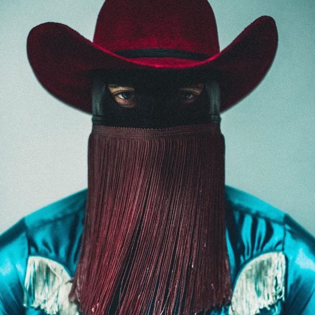 "Country musician @orvillepeck remains an anonymous figure, thanks to the fringed mask he always wears, choosing from more than 20 versions in his collection. He comes at a time when country music is having a renaissance, pushing outside the sphere of straight, white @garthbrooks–style men on guitar. There is the rise of @lilnasx and ""Old Town Road""; @iamyolaofficial, a black British musician who sings country; and even the likes of @Diplo and @postmalone, who have been wearing Western-style clothing. ""It seems that there is a resurgence of cowboy culture; I think that is helping country open us [up, by] showing its true diversity. Maybe it has always been there, but maybe it doesn't have the chance to be shown,"" says Peck. ""Different perspectives and diversity and different sounds within that genre are coming to the foreground and being embraced, and that is exciting."" Tap the link in our bio to read more. Photographed by @mollephoto"