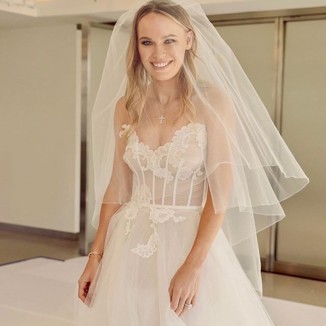 Tennis player @carowozniacki and former professional basketball player @davidlee are married! The happy couple recited their vows in front of 120 family and friends at @castigliondelbosco in Italy. Above @carowozniacki at her first dress fitting. Tap the link in our bio to see exclusive photos of the final dress. Photographed by @davidurbanke