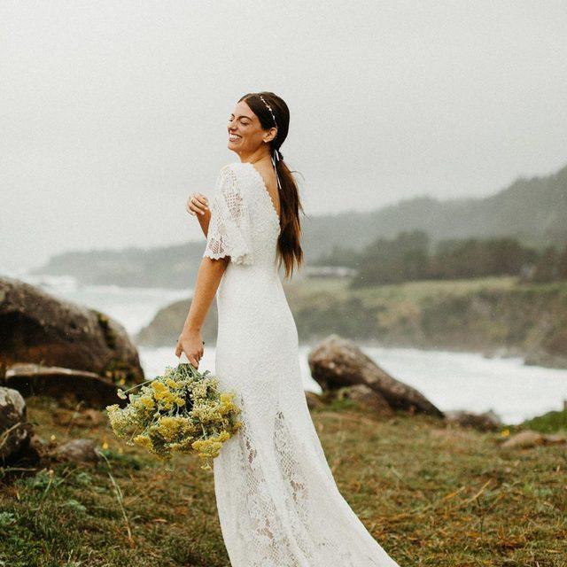 True love is the greatest adventure.❣️(tap to shop the Kieran Gown | 📷: indiaearl Bride: @mia_colona 💐: @missmelissfloraldesign)