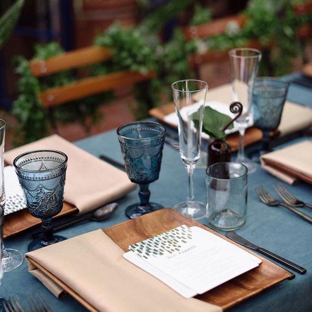 "Color crush: moody blues and earth tones. 🌿 ""Modern Dash"" @mintedweddings foil-pressed menu design @makewells. #MintedWeddings #WeddingWednesday — Photo @hazelnutphoto | Planner @showrunnerevents | Linens @latavolalinen | Florals @missmelissfloraldesign"