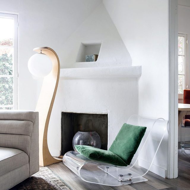 """Multidisciplinary designer and creative director Jaya Williams (@sensualmodern) has a thing for unusual design. In her L.A. home, she calls the Milo Baughman Bentwood Floor Lamp """"special and sensual and a little weird."""" As for the chair? """"The crazy, diaphanous magic-carpet-of-sorts chair is not super functional,"""" she explains, """"but it fits, and I love when people laugh at the outrageousness of the stuff I have."""" Take a tour of her space 👉 link in bio 📸 by @timhirschmann"""