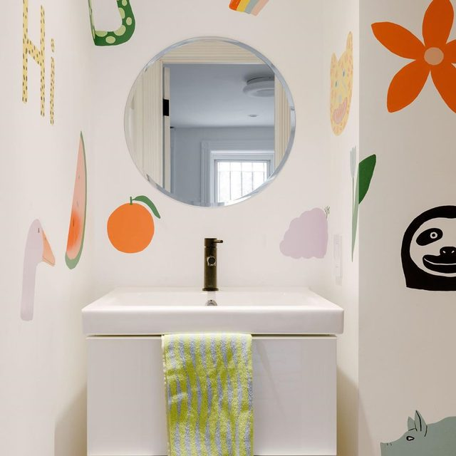 """When dreaming up a fun scheme for her bathroom, @dusendusen founder Ellen Van Dusen turned to her friend, artist @lorienstern to transform the white box into something special. """"At her house [Lorien] painted her bathroom with little watermelons everywhere (featured on Clever in August '18),"""" recalls Ellen. """"So I asked her, 'Lorien, will you paint my bathroom?' She said, 'Okay, just tell me all of your favorite animals and characters and I'll do it.' So I just selected all these animals. She painted my dog, Snips. She painted Snips's toy pig. We went to Costa Rica together and saw a bunch of sloths, so she painted a sloth. It's positioned right next to your head when you sit down."""" What a pal! 🙃 Take a tour of the entire apartment 👉 link in bio 📸 by @maxb.photo ✍️ by @_h_mart_"""