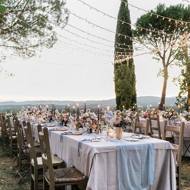 Twinkling lights and candles are the most popular ways to dress up a wedding reception, but we have 15 totally new ideas that will take it to the next level. 🤩 Head to the #linkinbio to see them all! | 📸: @jeremychouphotography 📋: @weddingsintuscany 💐: @larosacaninafirenze
