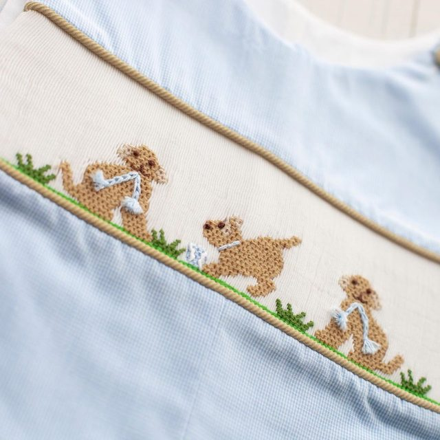 Playful puppy smock? Yes, please! Coming 7/18. 🐶 🐶
