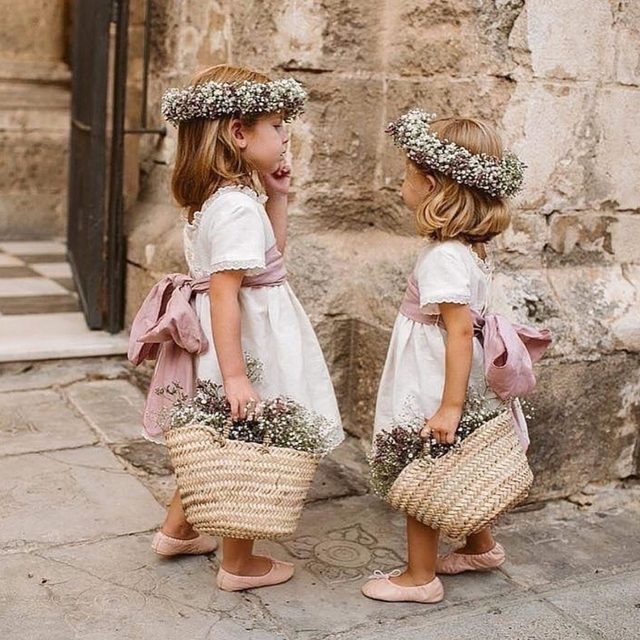 Flower girls so cute they *almost* stole the show. 🌸 Head to the #linkinbio for 9 gifts that are perfect for your littlest member of your bridal party! | 📸: @alejandrasalido 💐: @florenea