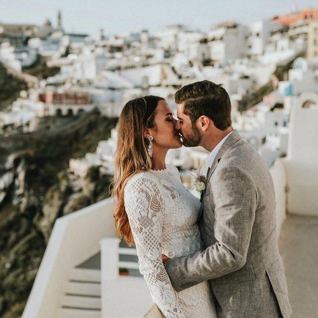 Our Tenley Gown is stealing the show at this stunning Santorini wedding. (tap to shop | 📷: @lighthousephotography_gr 💏: @blaykebernales + @samuelalexxander planning: @juliaandevita)