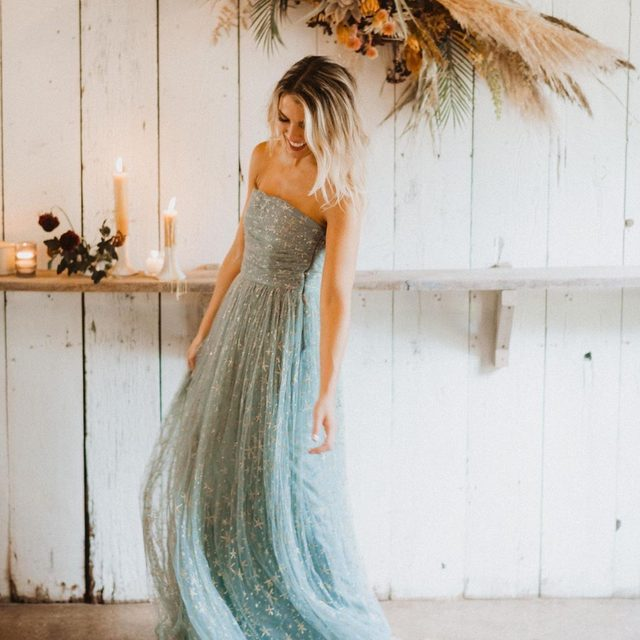 Embellished with glittering gold stars, our Brenda Dress shines for every occasion ✨ (tap to shop | 📷: @patrobinsonphoto | @salt_water_chic)