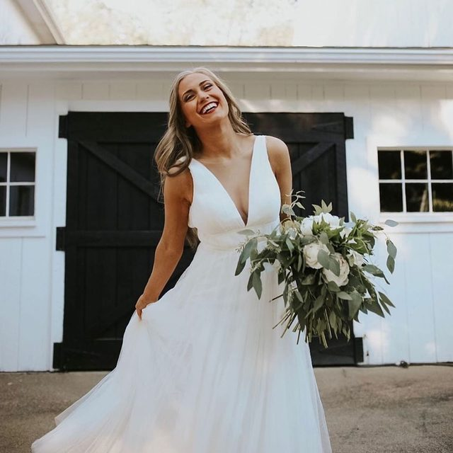 Pure bliss in our Sarita Dress! (tap to shop the look | 📷: @tayloranne_photo 💄: @jennifer.m.viveiros_makeup @hair_by_emilie94 👰: @eliizeddy 💐: @tlffc host: @styled_by_olivia)