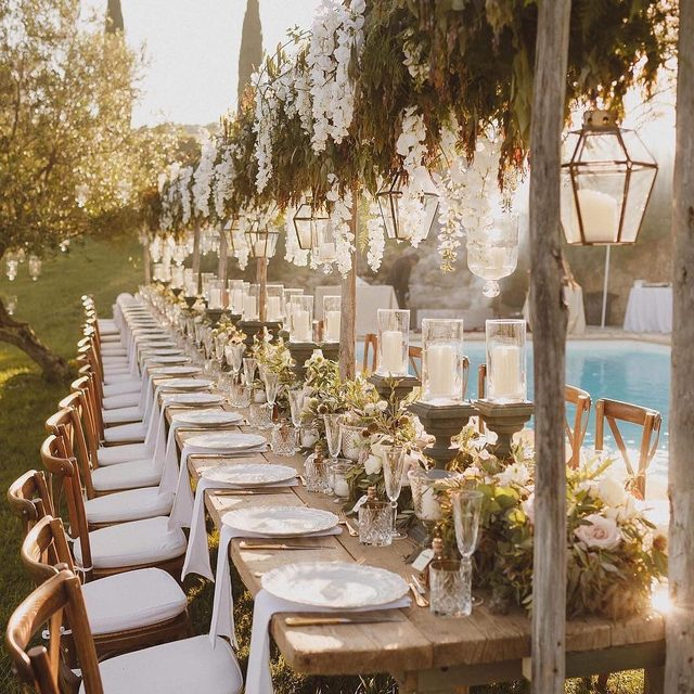A golden reception. 🌞 Head to the #linkinbio for 50 ways to save $500 on your wedding! | 📸: @edpeers 📋: @weddingsintuscany 💐: @tuscanyflowers