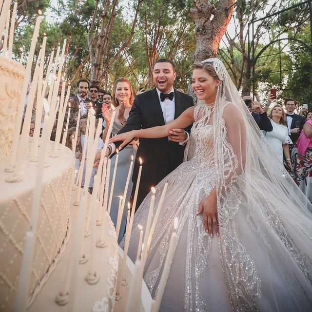 @kikamourad and @eliesjr (yes, he's the son of @eliesaabworld) tied the knot and to say their wedding was over-the-top would be an understatement. ✨ The bride wore more than 1,000,000 (!!!) sequins, their reception featured a 114-foot tunnel of greenery and their cake was larger-than-life. 🤩 Head to the #linkinbio to see the magic for yourself! #WeddingOfTheDay | 📸: @parazarme 📋: @ziadraphaelnassar