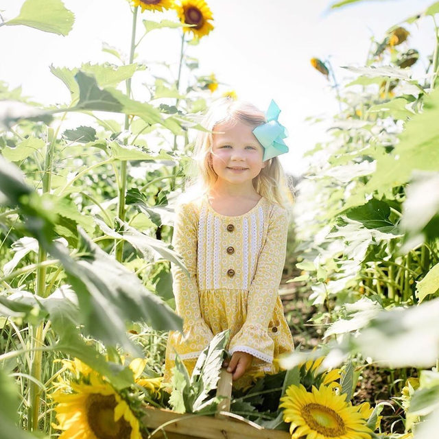 A little sunshine to brighten your Wednesday 💛🌻 Miss E is wearing our Solielle Dress available through the link in our profile | @lewissu50