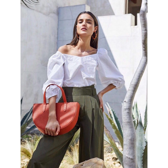 Architectural form meets versatile function.  Crafted from Italian pebbled leather, our Semi-Circle Bag is as sophisticated as it is practical. Pair it with our Seersucker Balloon Sleeve top for a complete summer look.