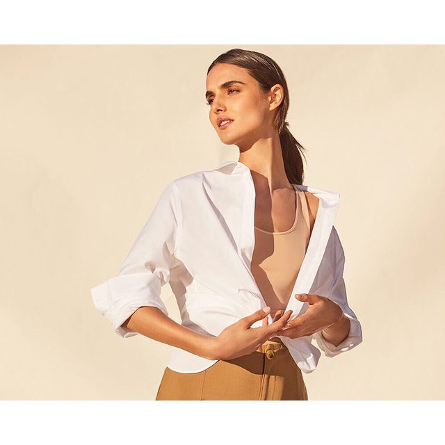 Our Poplin Pleat-Back Shirt.  Architectural details and an inverted back-pleat give this timeless piece an elevated look. Link in bio for three ways to wear it.