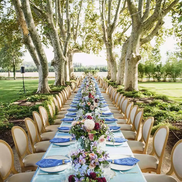 If you think this reception nestled between the trees of France is dreamy, just WAIT until you see the ceremony that came before it. 🥰 Head to the #linkinbio for a wedding that's almost too pretty to be true, especially because the bride found her venue on INSTAGRAM! 😱#WeddingOfTheDay | 📸: @rossharvy 📋 & 💐: @matthewrobbinsdesign