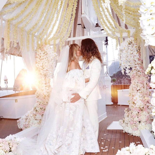 Heidi Klum and Tom Kaulitz are married...again! 💍 Head to the #linkinbio for all the details on their second wedding in Capri, including how it was on the same 395-foot yacht Jackie Kennedy got married on. | #regram: @heidiklum