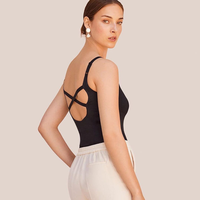 Our Seamless Cross-Back Bodysuit  A feminine, foundational piece that allows you to be comfortable in your own skin, no matter the occasion.