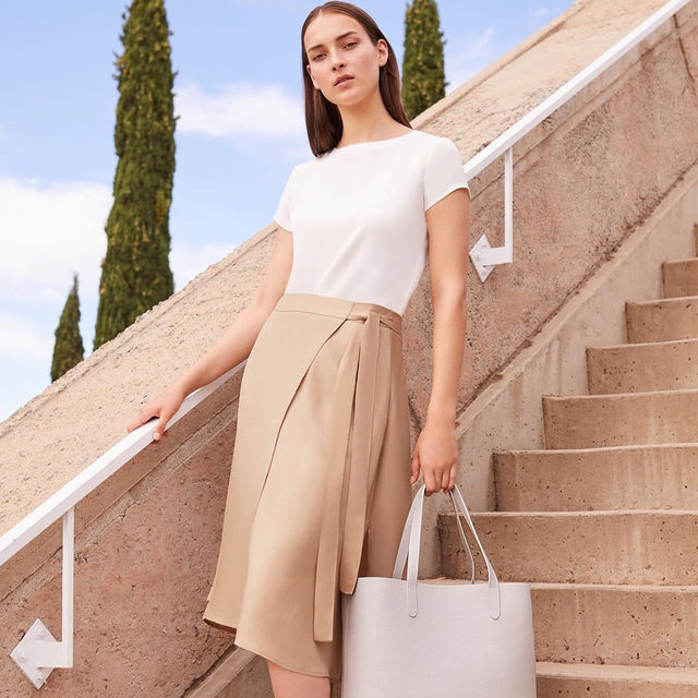 Fall is arriving with flair.  Introducing our new Wrap Skirt, designed to flatter any shape. Available in two neutral hues and versatile in every way.