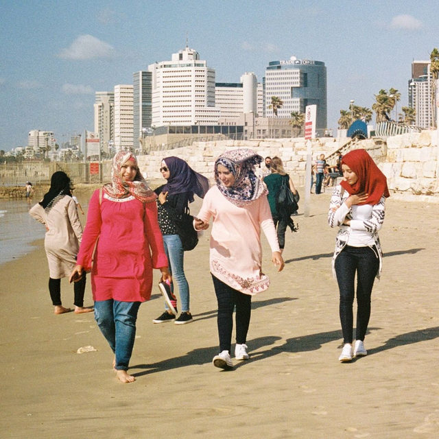 The modern seaside city of Tel Aviv is poles apart from religious hubs like Jerusalem or Tzfat. Here, on the Mediterranean coast, the beach is a daily congregation of flesh, salt, and tattoos. Tap the link in our bio for a look at beach style in Tel Aviv. Photographed by @thisismayan