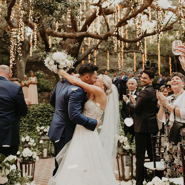 Exclusive: 350 guests got to witness NFL star @bakermayfield and @emilywmayfield's wedding in Malibu and to say we're jealous is an understatement! ✨✨ From the couple's jaw-dropping ceremony to the ferris wheel at their reception and everything in between, this party belongs in the (weddings) hall of fame. 🏈 Head to the #linkinbio for all the exclusive pictures! #WeddingOfTheDay | 📸: @hayleydolson 📋: @charleybluebell 💐: @marksgarden