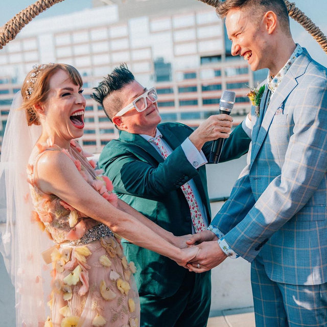"Exclusive: Orange Is The New Black's Emma Myles and Darcy Cadman are married and her costar @realleadelaria officiated! ❤️ Head to the #linkinbio to see her ""nautical floral fairy dream"" wedding complete with @hooters and her OITNB crew! 🌈 #WeddingOfTheDay 