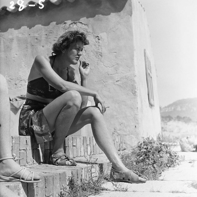 We're accustomed to seeing Julia Child—who was born on this day in 1912—hooting over a slippery chicken in the kitchen. But in a book of photographs taken by her husband, Paul Child, we see her through his lens—sunbathing on a rooftop, laughing, or arranging a picnic. He can't keep his eyes off her. Tap the link in our bio to read more about Julia Child before all the books, television, and fame. Photograph by Paul Child / © The Schlesinger Library, Radcliffe Institute, Harvard University.